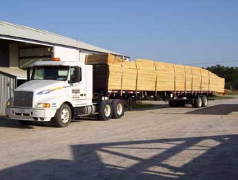 Truck delivering wooden trusses